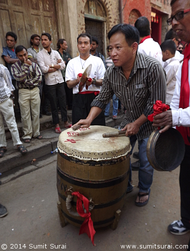 The lion dancers perform to his beats