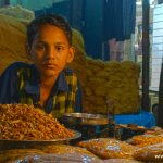 Boy selling dry fruits