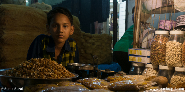Boy selling various dry fruits