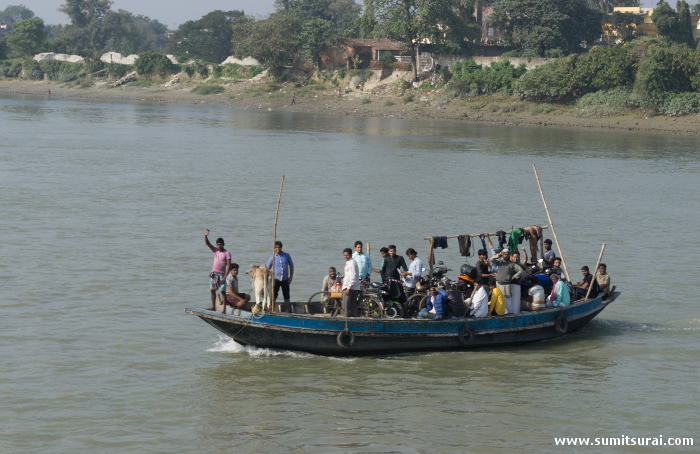 Locals crossing the river from Howrah side